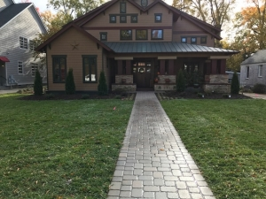 Concrete and asphalt will eventually crack, leading to re-surfacing and patchwork.  Pavers will stand the test of time.  This paver lead walk makes an immediate impact in terms of curb appeal.