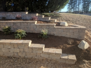 Constructing retaining walls are a great solution for steep grades and slopes.  This is a great option if you have the desire to landscape an area on a slope or uneven terrain.