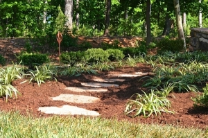 Walking paths are a great feature in your woodland garden.  They function as a way to take a leisurely stroll throughout your space.  Natural stone is hard and organic so it will last a lifetime in the elements. It also defines our design approach which is to use sustainable, natural materials.
