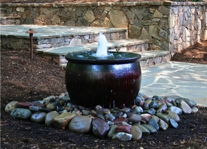 Adding water features are great accents in woodland gardens.  They are often times spoken of as resembling the sound of a tranquil stream or creek in your backyard.